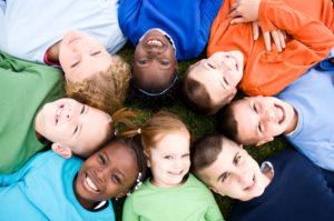 Children smiling together in a circle