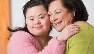 youth with down syndrome hugging mom