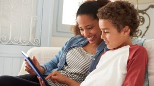 parent and child learning on laptop