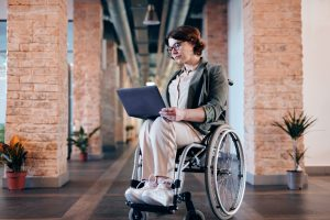 woman working on laptop in wheelchair